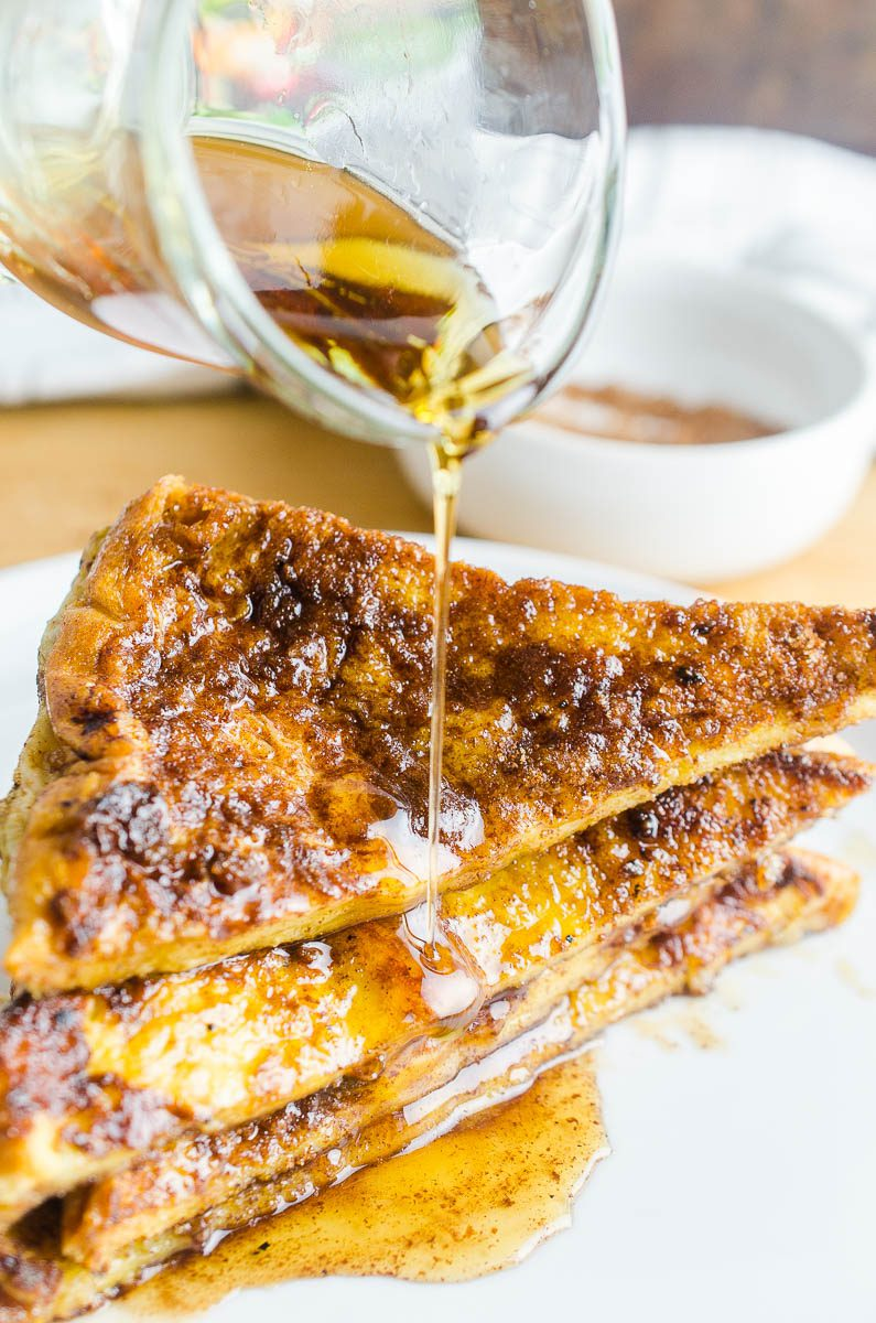Pouring syrup on easy cinnamon french toast
