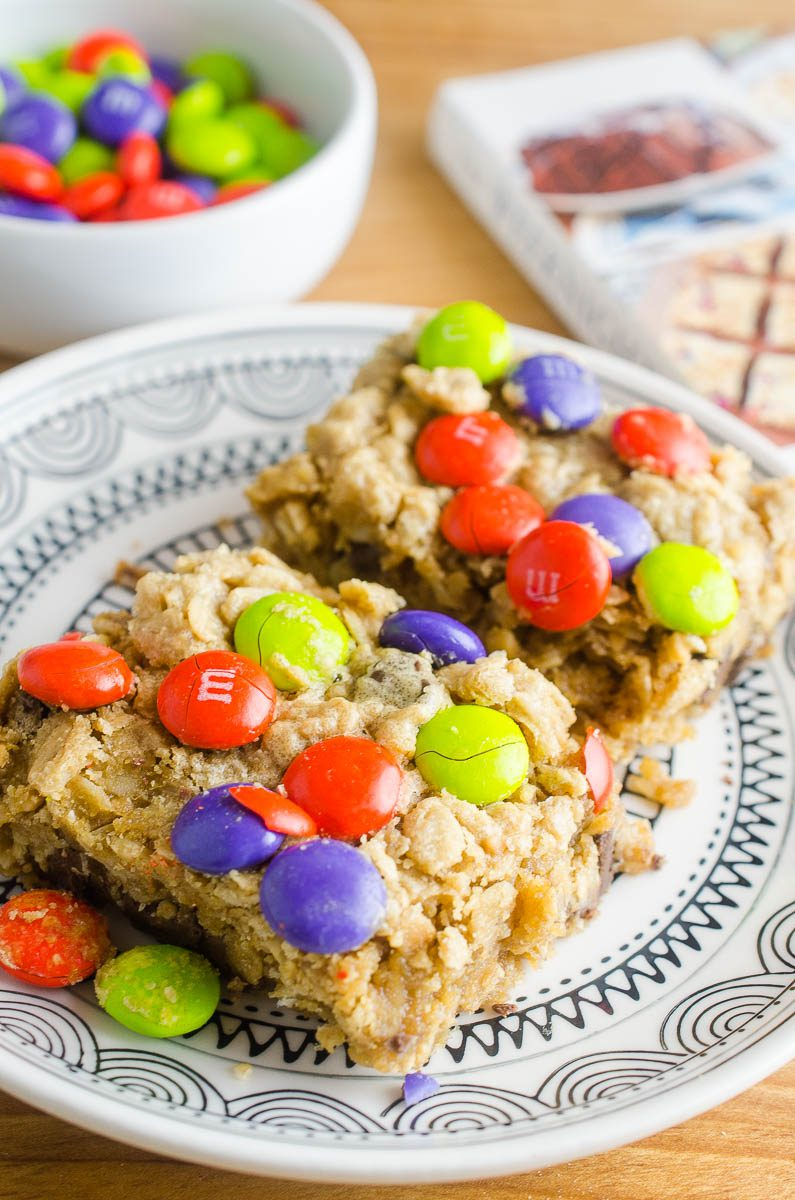 Easy and chewy Monster Cookie Bars are a perfect afternoon treat for kiddos! Change out the colors of the M&Ms for all of your favorite holidays!