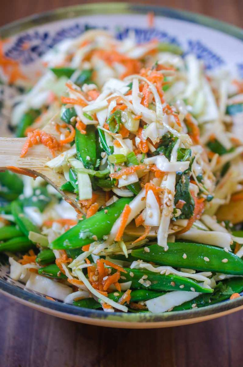 This Asian Cabbage Salad is a quick, easy and refreshing salad with cabbage, snap peas and carrots in a savory ponzu dressing.