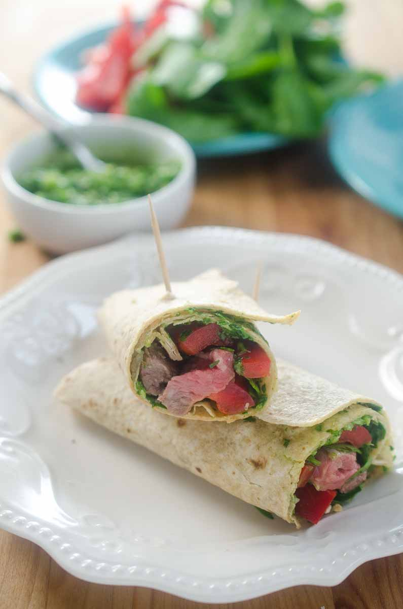 Chimichurri Steak Wraps make a great lunch or dinner! An easy chimichurri sauce adds big flavor to wraps made with steak, spinach and red bell pepper.