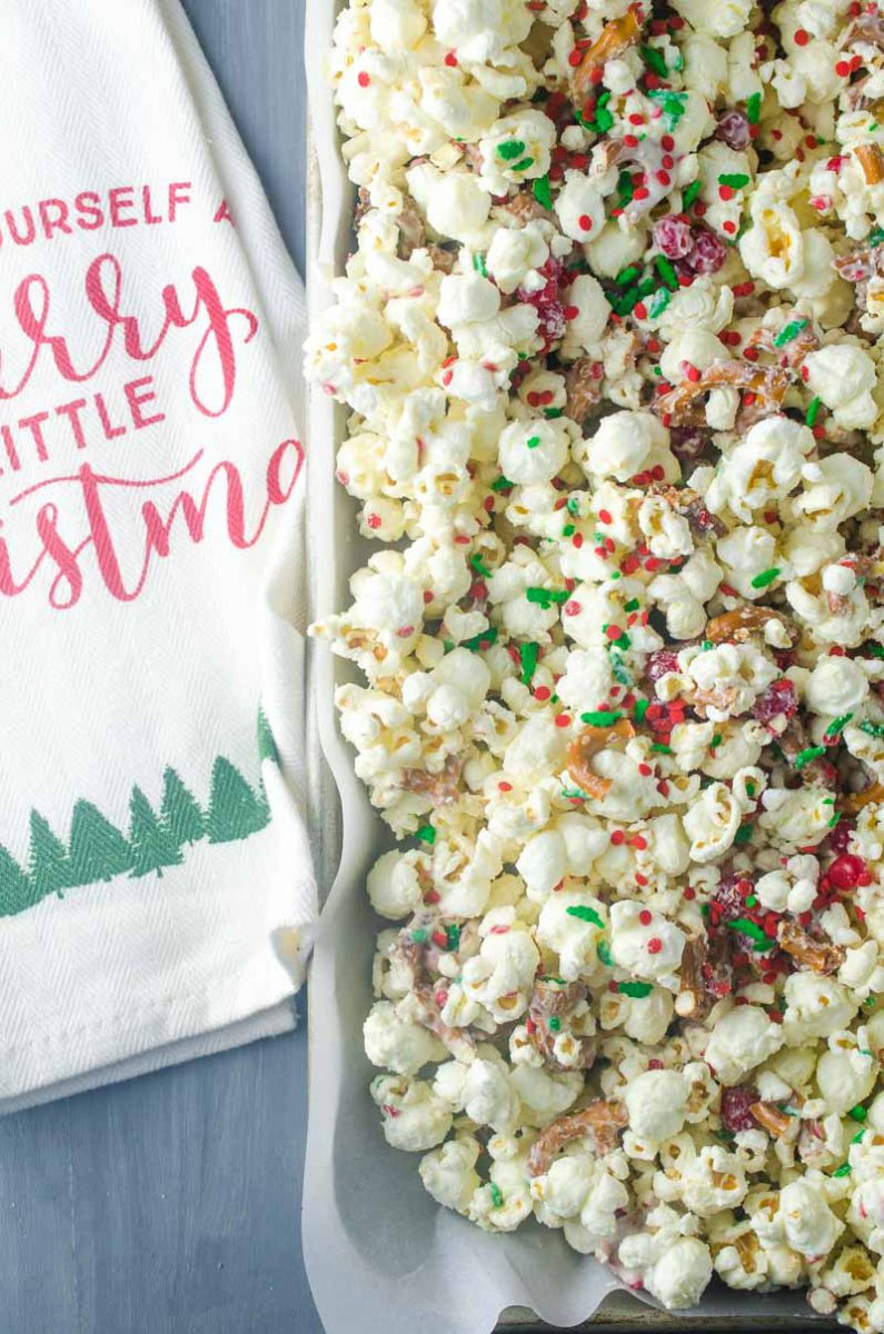 cinnamon christmas popcorn with white chocolate cinnamon candies and sprinkles will be your new favorite