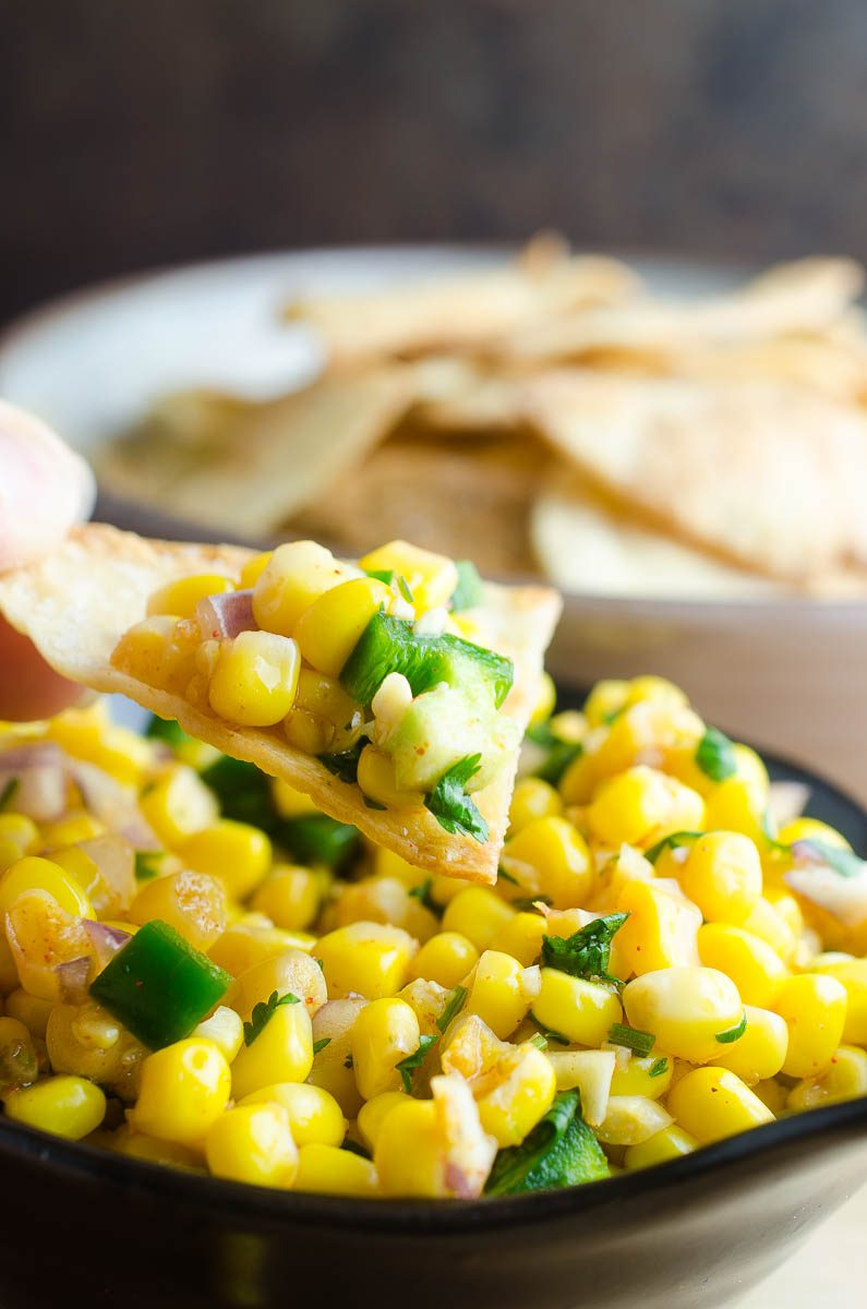 This Easy Corn Salsa recipe makes the perfect addition to tacos, chips and even salads. It comes together in a flash and is a total crowd pleaser.