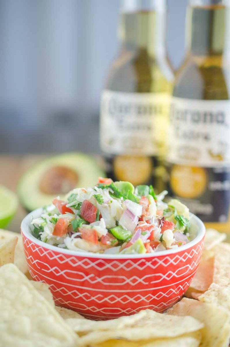 Crab ceviche is a fun twist on a classic! A mixture of Dungeness crab, tomatoes, serrano peppers, onions, lemon, lime, cilantro and avocado. It's like sunshine in a bowl.