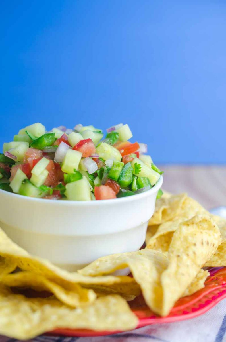 Cucumber Salsa is quick easy and will be your new favorite way to use cucumbers. Only 6 ingredients: cucumbers, lime, tomatoes, cilantro, onion & jalapeño.