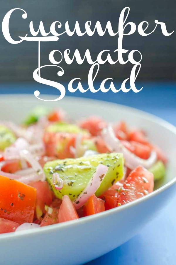 Cucumber Tomato Salad is my absolute favorite summer salad. Fresh cucumbers, summer tomatoes, shallots and a quick vinaigrette make this perfect for all of your summer cookouts.  #vegetarian #cucumbertomatosalad #salad