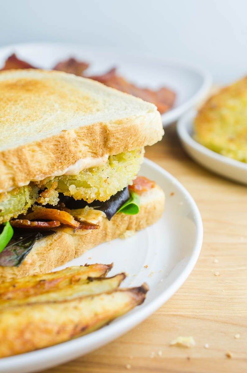 A fried green tomato BLT combines two classic foods into one comfort food sandwich. Fried green tomatoes and a bacon, lettuce and tomato sandwich become an epic Fried Green Tomato BLT. Topped with Cajun mayo spread, this will become your new favorite sandwich recipe!