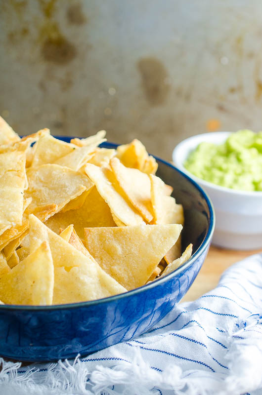 All you need to make your own homemade tortilla chips is 3 ingredients and 15 minutes in the oven. They are great for dipping in all the things!