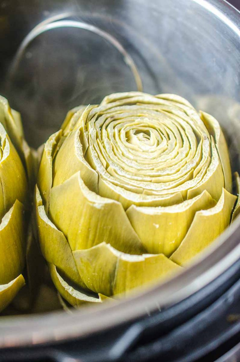 Making Instant Pot Artichokes is incredibly easy! This recipe shows you how and even includes a creamy herb dipping sauce to serve along side!