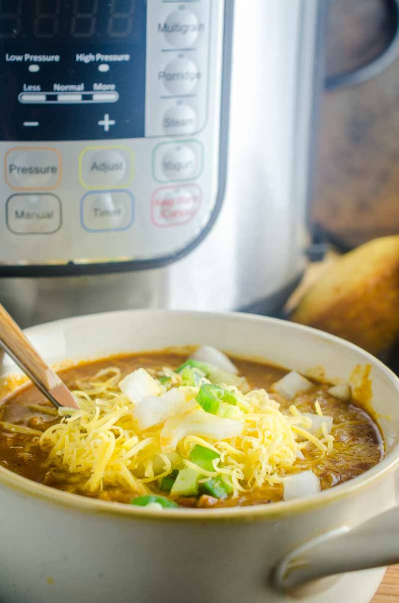 Instant Pot Chili is hearty, loaded with goodies and perfect for a cold winter's day or for your game day celebrations. And it couldn't be easier to make!