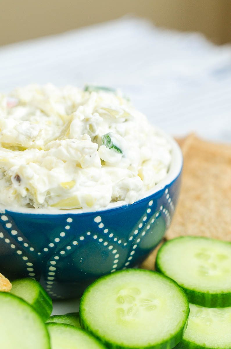 Creamy Artichoke Jalapeño Dip is a summer potluck must! Loaded with two cheeses, artichokes and jalapeños, it's impossible to resist.