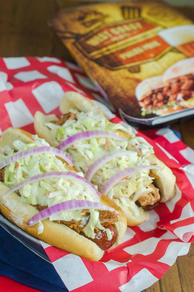 Take your summer hot dogs to the next level with Pulled Pork Hot Dogs. Hot dogs loaded with pulled pork, creamy coleslaw and red onion.