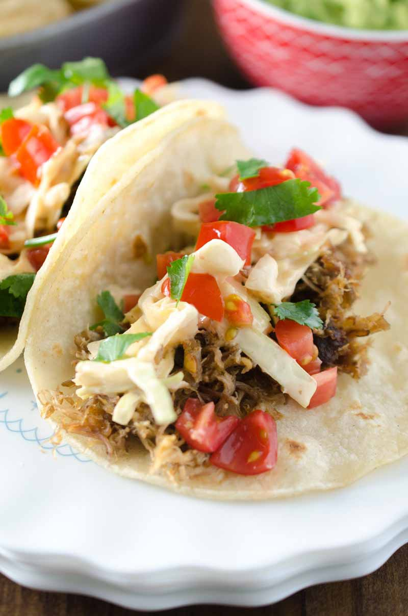 These Pulled Pork Tacos with Chipotle Slaw are packed full of flavor and a great addition to your Taco Tuesday!