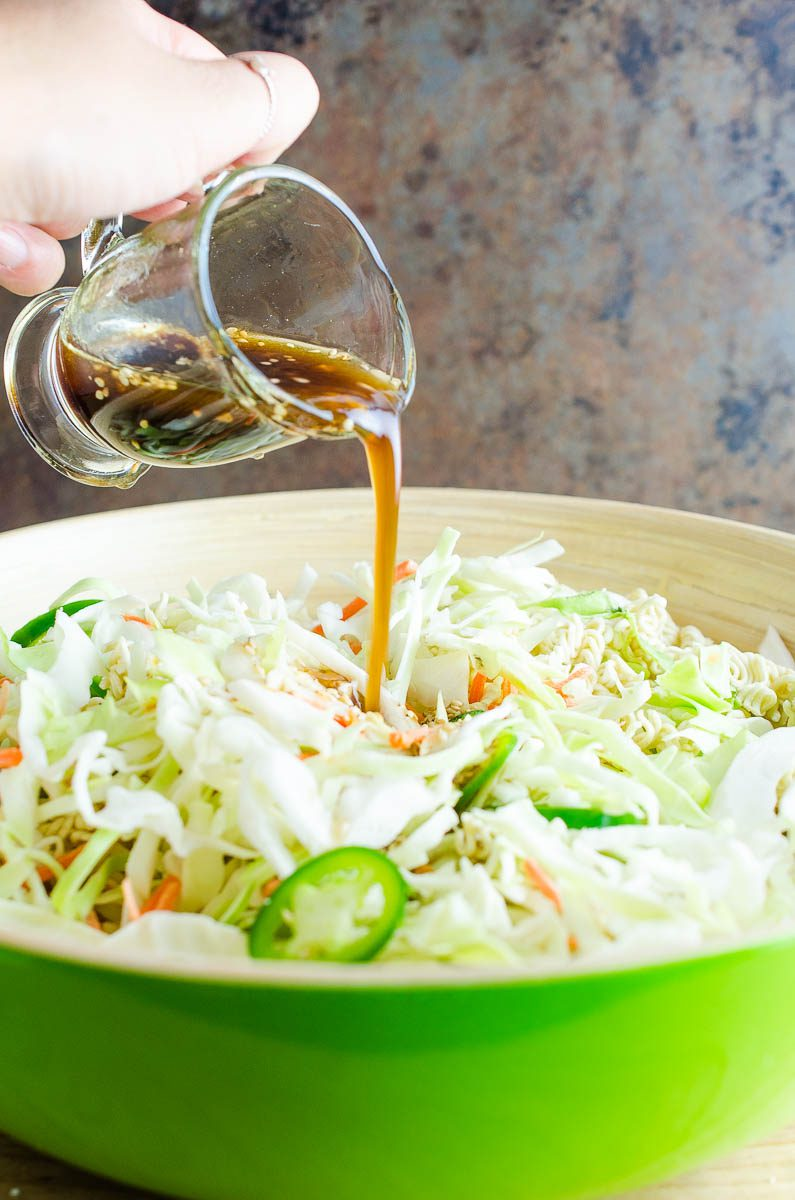 Pouring dressing on Ramen Noodle Salad