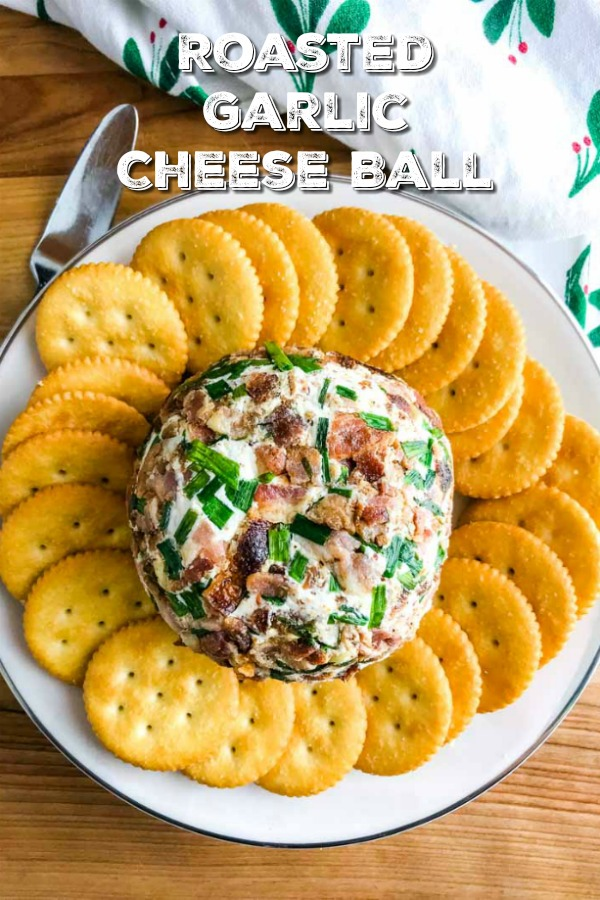 This Roasted Garlic Cheese Ball is a MUST MAKE party appetizer! It's easy, loaded with roasted garlic, 2 cheese and coated in bacon and chives. #cheeseball #cheese #appetizer #partyfood #footballfood