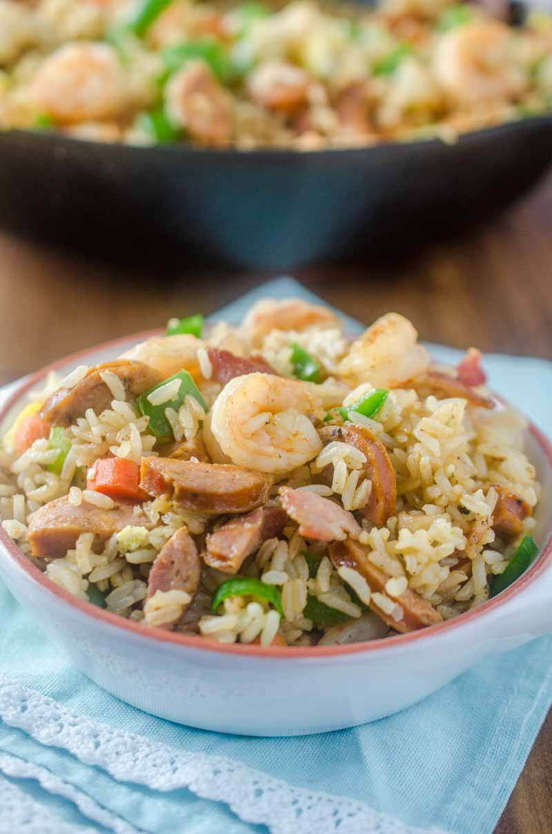 Andouille and Shrimp Fried Rice is loaded with all kinds of goodies! Spicy andouille, succulent shrimp, eggs, bacon and veggies.