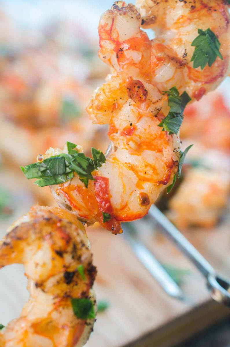 Spicy Grilled Shrimp is the perfect recipe to add a little kick to your next BBQ. With only 3 ingredients and less than 10 minutes on the grill, they are ready in a flash too!