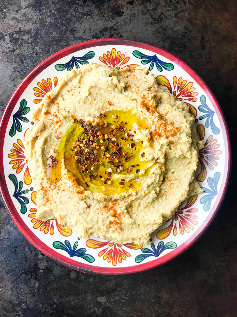 A kicked up version of traditional hummus with lime, crushed red pepper and cayenne. Spicy Hummus is a great addition to your party dip spread.