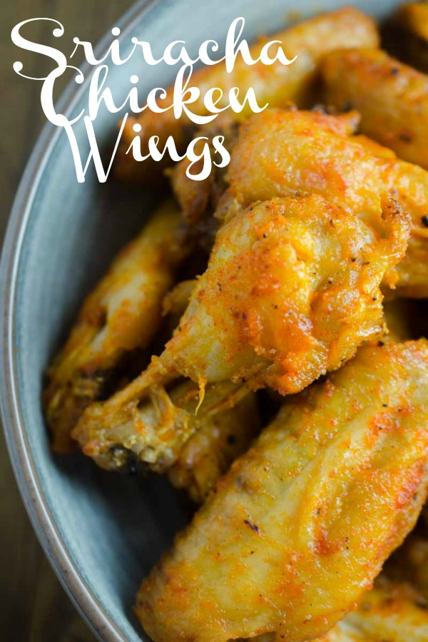 Sriracha Chicken Wings are baked to perfection and then tossed in a spicy sriracha sauce. They will be your new favorite chicken wing! #chickenwings #sriracha #bakedchickenwings #chicken