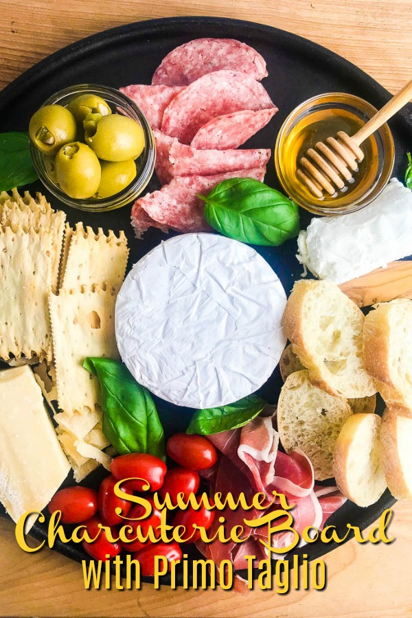 This Summer Charcuterie Board is loaded with 3 different kinds of cheese, meat, olives, tomatoes, crackers and sweet honey. It's perfect for all of your snacking this summer.  #ad #charcuterieboard