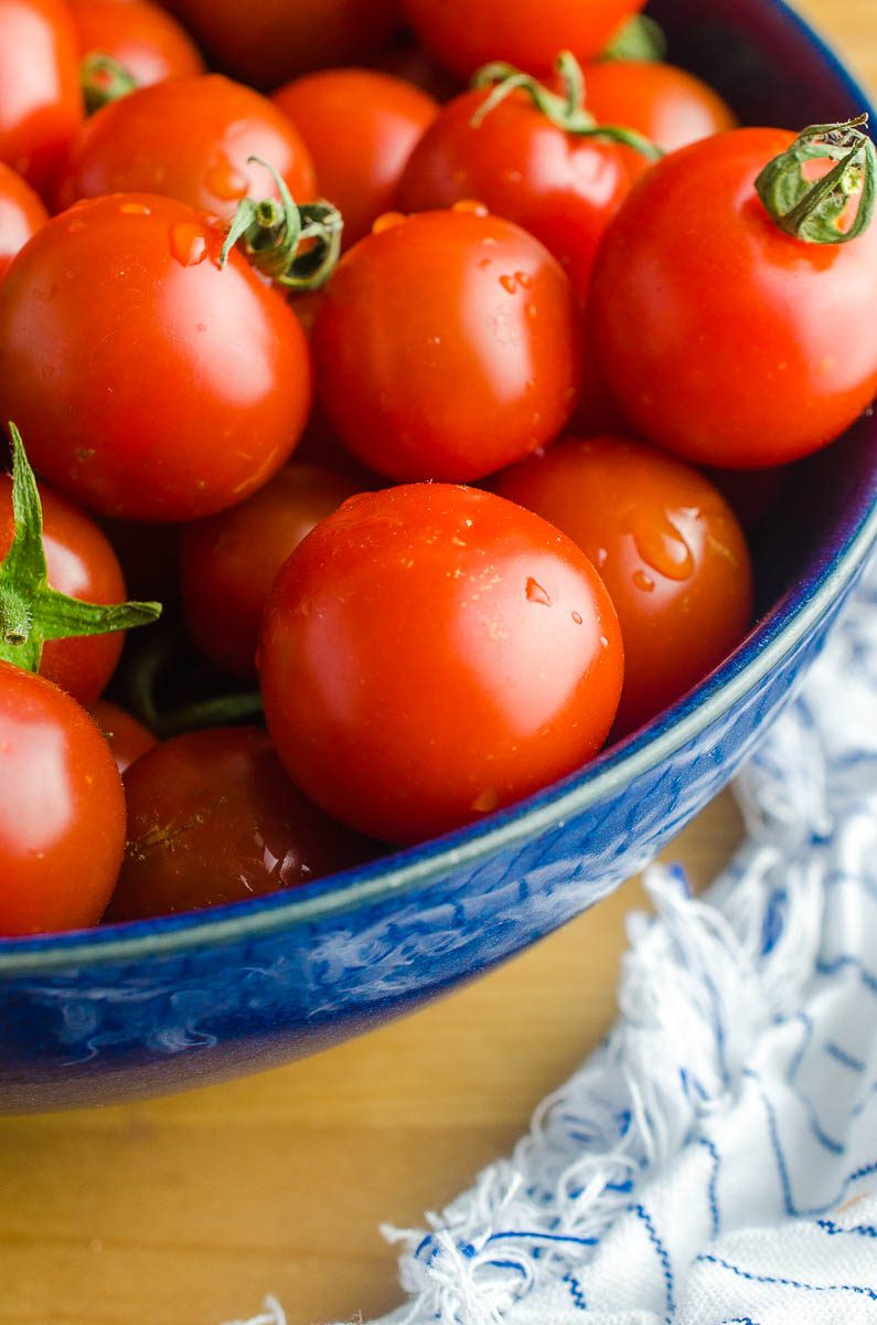 A bowl full of fresh summer tomatoes