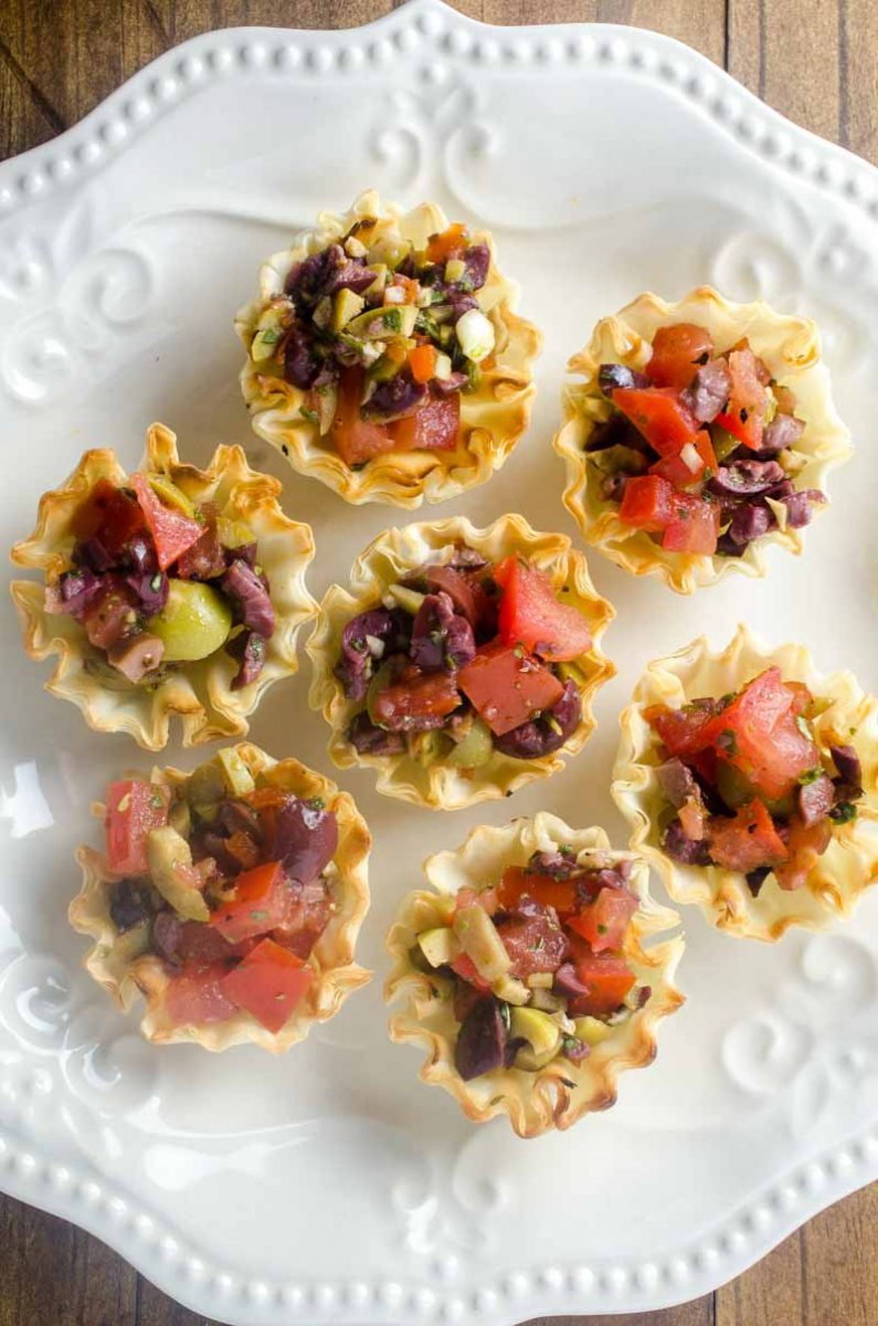 Tomato Olive Phyllo Cups are the perfect party appetizer. Fresh tomatoes and briny olives piled high in crispy phyllo cups. Ready in less than 10 minutes!