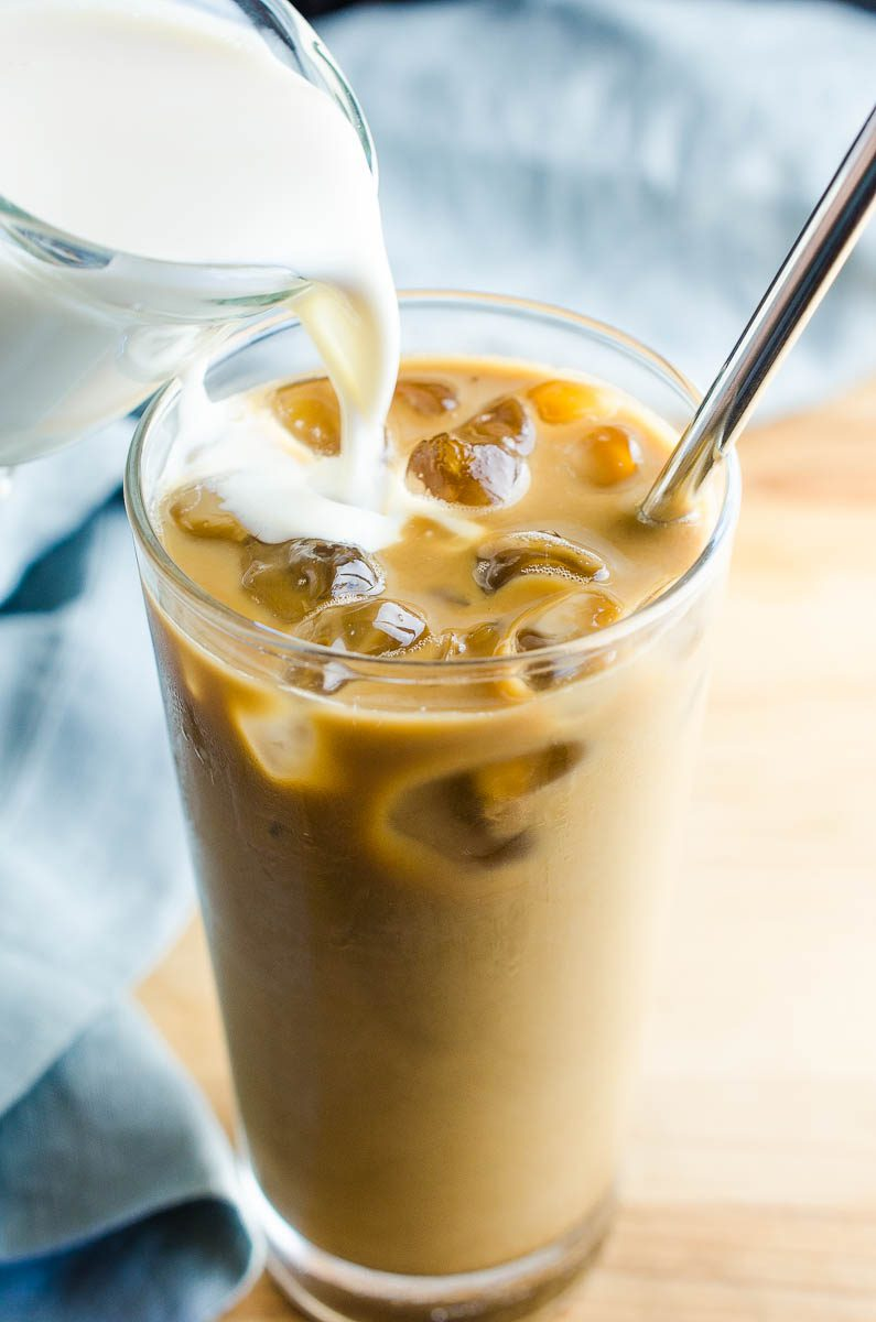 Pouring vanilla sweet cream into ice coffee. Looking for other homemade coffee creamers?