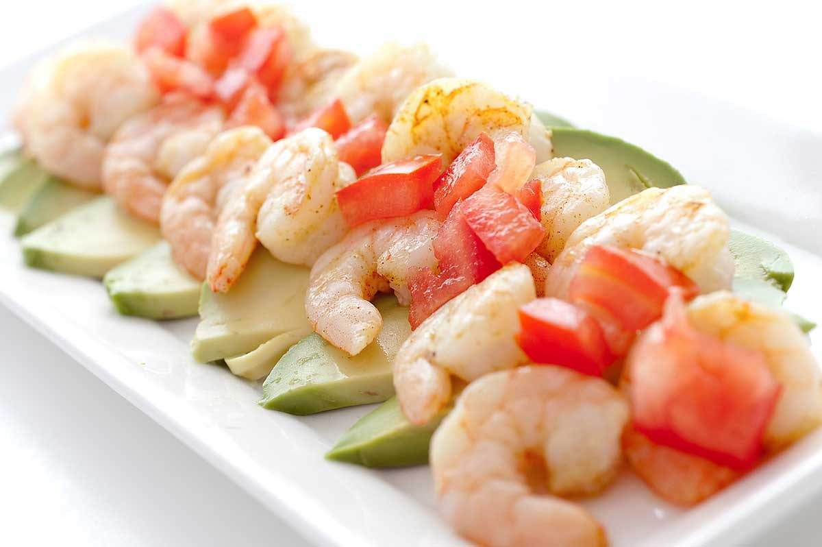 Adobo Shrimp on a bed of sliced avocado, topped with tomatoes and a squirt of lime. Quick, easy and a reminder that summer is just around the corner.