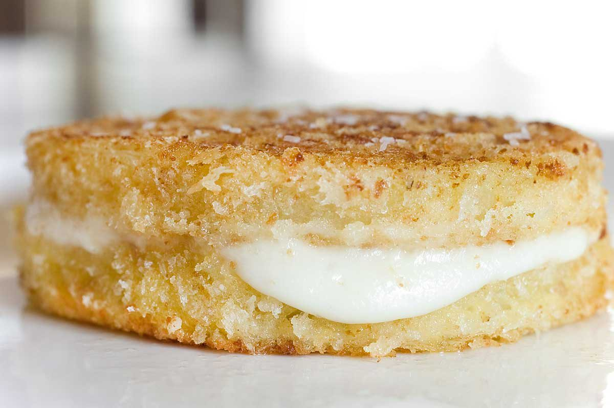 Oooey, gooey mozzarella sandwiched between two crispy, crunchy fried green tomatoes.